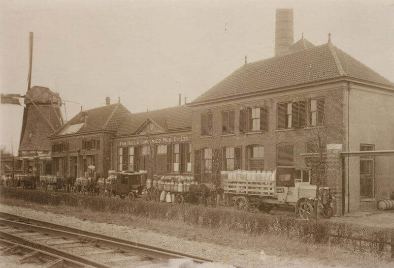 Van Heel factory in Kampen with a mill and truck filled with milk canisters next to it