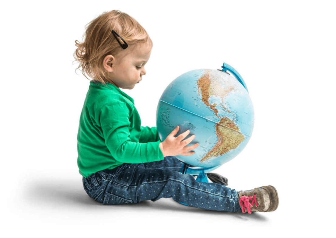 Little girl sitting on the ground with globe in her hands